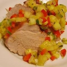 Fresh pineapple, peppers, and cilantro bring a bright and summery flavor to this pork tenderloin. Though it's great in the summer, try it all year round.