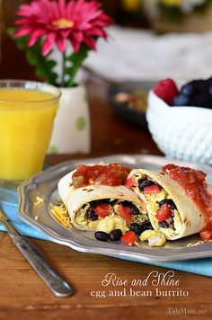Rise and Shine Breakfast Burritos.  A delicious, filling breakfast that can be devoured around the table at home or wrapped and enjoyed on the go. Recipe at TidyMom.net
