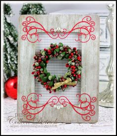 Wooden frame from craft store, painted, distressed, lined with patterned paper.  A candle ring stands in for a Christmas wreath, and some die cuts and pearls finish dressing it up.