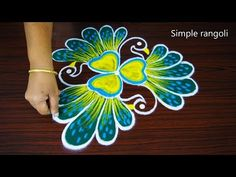 3 Face Peacock rangoli design - Simple peacock kolam with dots for beginners with color for all Rangoli Designs Peacock, Indian Rangoli Designs, Rangoli Designs Latest, Rangoli Border Designs, Rangoli Patterns, Rangoli Designs Images, Rangoli Designs With Dots, Rangoli With Dots, Beautiful Rangoli Designs