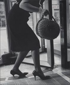 Vintage photo of a chic lady with a great purse getting her heel stuck in a grate.