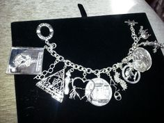 Sterling Silver Charm Bracelet with 13 charms reflecting official and traditional symbols of Delta Sigma Theta Sorority, Inc.