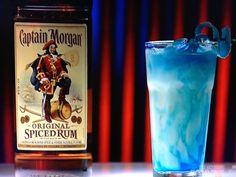 Out of the Park. 0.25 oz blue curaçao 1.25 oz Captian Morgan Original spiced rum 3 oz Piña Colada mix Shake Captain Morgan and Piña colada mix. Strain over blue curaçao. Garnish with blue candy bacon.