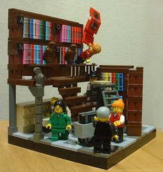 VignetteBricks: Miss Librarian, in the library, with a slippery stepstool - Lego library vignette
