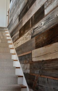 Reclaimed barnwood wall- basement stairs - love this idea for a spot that is hard to decorate. [we're changing the varnished plywood wall next to the stairs, i wonder if we could do a bit of this idea. Wood Wall Design, Pallet Walls, Wood Walls, Pallet Wood, Grey Walls, Into The Woods, Basement Stairs, Basement Flooring, Stairwell Wall