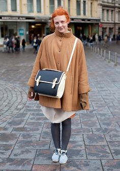 """I'm wearing a coat from H&M and a vintage bag and shoes from Berlin.I like to wear dresses, blue and beige."""