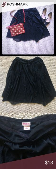Black Tulle Skirt This is a black tulle skirt that is in great condition. It has an elastic waist. The tag says medium but would fit a large too. Only been worn twice. Xhilaration Skirts