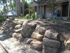 Wish i could replace our ugly cracked retaining wall with something like this!