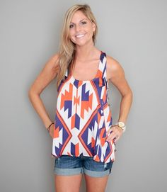 Love this outfit for the summer...rolled up shorts, orange and purple flowy native american-esque top
