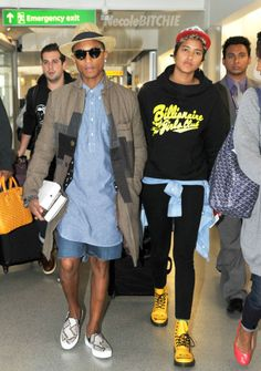 Pharrell Williams and Helen arrive at LAX airport