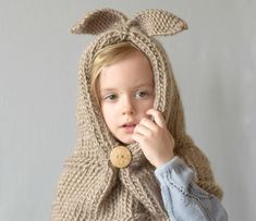This simple bunny knit hood is adorable for spring, Easter or any time of year. If you know how to knit, purl and knit two together, you can make this hat for the little girl in your life!