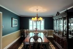 Traditional Dining Room with Chair rail, Crown molding, Hardwood floors, Built-in bookshelf, Chandelier