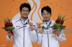 Junja Koga (silver) of Japan, Ryosuke Irie (gold) of Japan pose with the medals won in the Men's 100m Backstroke at the Aoti Aquatics Centre during day four of the 16th Asian Games Guangzhou 2010 on November 16, 2010 in Guangzhou, China.