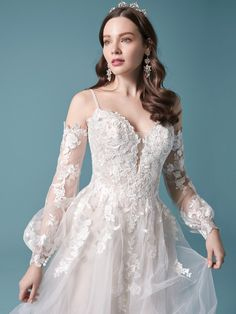 The stylish cold shoulder bishop sleeve princess wedding dress for the modern bride made by Maggie Sottero. Find your one-of-a-kind bridal gown today! Maggie Sottero Wedding Dresses, Colored Wedding Dresses, Dream Wedding Dresses, Designer Wedding Dresses, Bridal Dresses, Wedding Gowns, Ethereal Wedding Dress, Princess Wedding, Mermaid Dresses