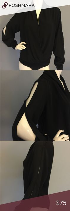Black Body Suit Fabulous Long Sleeve Black Body Suit, dress up or down.  Never worn! ANTONIO MELANI Tops Blouses