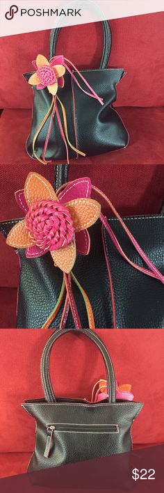 Mellow World black purse with multi flower Wonderful black purse with a splash of color. Bright pink and orange flower with tassels is attached to one of the two handles. Even has a tiny splash of green. Purse is in overall good condition with very minor wear. Zipper closure. One zippered inside pocket and two inside slip pockets. Mellow World Bags Mini Bags