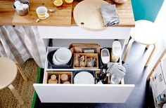 Turn a drawer into a one-stop shop with everything the kids need to start their day right. Divide it up into little compartments for bowls, spoons, cereal, bread and more with the help of baskets and boxes.