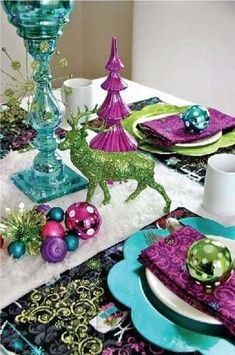 #Holiday table decorations in vibrant turquoise and purple colors