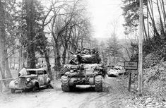 A column of M4 Sherman tanks of the 7th Armored Division entering the town of Lohlbach, Germany, 1945.