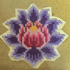 Pretty lotus flower adapted for perler from a cross stitch pattern. Also has an om that will go above it~