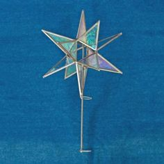 Dress up your tree with this beautiful tree topper. The Moravian S...