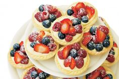 These impressive-looking pastry tarts are filled with custard, cream and vibrant berries.