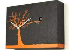 Albero Modern Cuckoo Clock  We're crazy about this Albero Modern Cuckoo Clock ($350). Constructed in Italy of wenge painted wood, it boasts cool branch hands in orange or white and an adorable cuckoo who calls the hours. A conversation, as well as a time, piece.