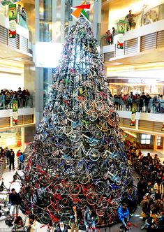 Pedal power: Hundreds of shoppers turned out to see the tree unveiled