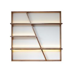Ivar London interior design Brompton walnut wood book case front view packshot highlighted by the LED strips. It can be built in or hang to the wall and used for luxurious ornaments or to expose your favourite books.