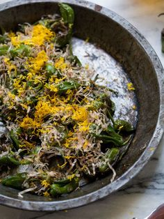 This Padrón peppers recipe has a mild spice along with an earthy flavor from bonito flakes and orange zest.