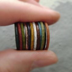 Hammered copper stacking rings in painted metal patina.