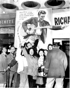 Fans line up to see Presley's first movie 'Love Me Tender,' in 1956. The Colonel had gotten him a screen test with Paramount Studios and was signed to a one-picture contract with an option for 6 more.  Read more: http://www.nydailynews.com/entertainment/music-arts/elvis-presley-75th-birthday-gallery-1.102843?pmSlide=1#ixzz2jG2UMYSa