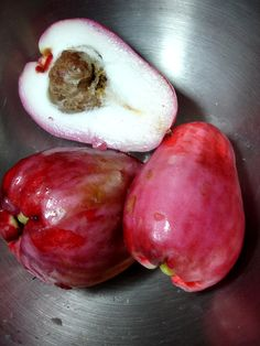 Otahiti apple -- yes, that's its real name -- is from the Caribbean. It has a hairy seed and tastes like a less-sweet combination of a pear and an apple. I've never seen it in the USA.