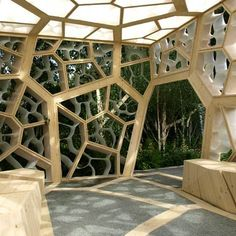 British architects NEX have designed this cubed timber pavilion for the Chelsea Flower Show in London with the same structural form as a leaf.    Eureka Pavilion by NEX    Between the gaps in the timber capillaries are smaller framework elements made from recycled plastic, curved to resemble leaf cells.: