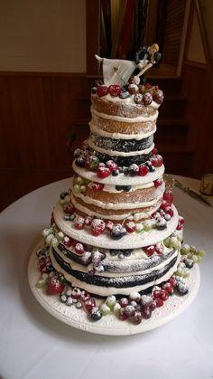 Naked wedding cake: chocolate and vanilla cake, whip cream icing, raspberry, coconut and banana fillings, fresh fruit.