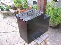 Here is the stove painted in a semi-gloss black engine block spray paint. If the dust was wiped off you would see that the paint is thin on. Stock Tank Heater, Stove Paint, Camping Pod, Phase 2, Spray Painting, Tub, Backyard, It Is Finished, Building