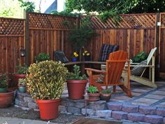 Building a retaining wall to level out the yard enabled the creation of this cozy spot.  http://www.hgtv.com/landscaping/outdoor-rooms-we-love-from-rate-my-space/pictures/page-9.html?soc=pinterest