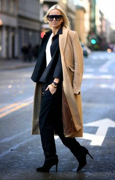 Business chic: Camel coat over black suit #StreetStyle