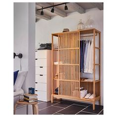 Here's bedroom inspiration that shows how to create a stylish and streamlined look thanks to furniture in bamboo that blend in beautifully with your bed frame, chest of drawers and bed textiles. Visit IKEA and find your new furniture favourites in bamboo. Bamboo Furniture, Bedroom Furniture, Furniture Design, Diy Wardrobe, Wardrobe Design, Ikea Open Wardrobe, Black Wardrobe, Pallet Wardrobe, Clothes Rail