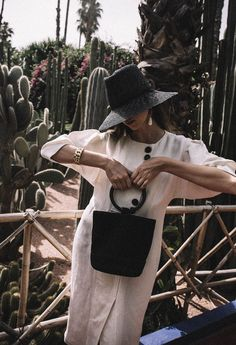 Simon Miller bonsai bag worn by fashion blogger Beatrice Gutu with Mango Committed linen dress and black straw hat outfit ideas for Jardin Majorelle