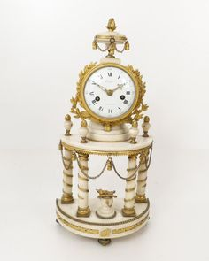 "Very nice #portico #clock #LouisXVI in white #marble and ormolu. Decoration of acanthus leaves interleaved along the columns, in the center a bird sitting on a cushion. The wire movement has the name of ""Orange at Versailles"". Balance-wheel in the form of sunlight. Period late 18th early 19th. For sale on #Proantic by Antiquités Du Golfe."