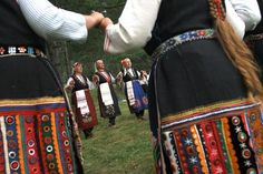 Koprivshtitsa, BULGARIA: Bulgarian women sing as they dance 'horo', a folklore chain dance, at the ninth National festival of Bulgarian folk art in the town of Koprivtitsa, some 120 km east of Sofia, 04 August 2005. Photo credit VALENTINA PETROVA/AFP/Getty Images