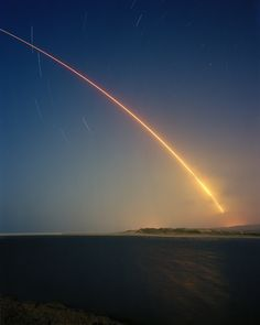 Glory Trip 197. An unarmed Minuteman III nuclear missile with a National Nuclear Security Administration experiment on board is launched from Vandenberg Air Force Base in California. The missiles single unarmed Re-Entry Vehicle travelled 5250 miles to a target area just of Guam, 22 May 2008. Image © Simon Norfolk, from the series Full Spectrum Dominance.