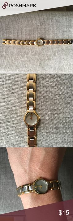 Citizen watch with gold and silver band. Citizen watch with gold and silver band. Great watch for everyday use. Battery is common and can be repaired at local jewelry store. Make me an offer! Citizen Accessories Watches