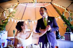 Happy tipi wedding, with a gorgeous couple - fairly lights, bunting and ivy, pretty!