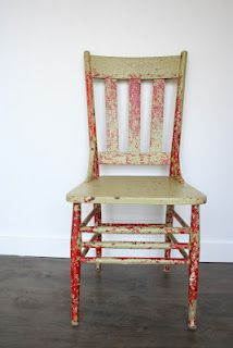 Green/red chippy wooden chair.