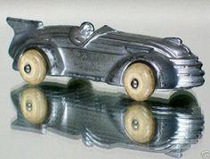 An Art Deco era toy car.