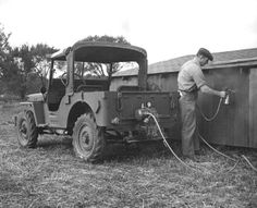 STRANGE OLDE FARM EQUIPMENT - WWII JEEP WITH PTO FOR FARM IMPLEMENTS - AIR COMPRESSOR - SPRAY PAINTING