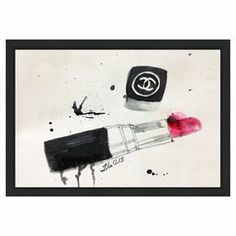 Framed print with a graphic Coco Chanel lipstick design. Made in the USA.    Product: Canvas printConstruction Material: WoodFeatures:  Limited open edition with certificate of authenticity by the artistMade in the USAReady to hang  Note: Hanging hardware includedCleaning and Care: Dust lightly using a soft, clean and lint-free cotton cloth
