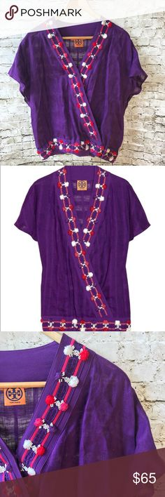 Tory Burch Purple Linen Embroidered Top NWOT Tory Burch NWOT $350 Purple Linen Embroidered Wrap Top SZ 4 Purple linen plunging v-neck wrap top by Tory Burch. This top features silk trim throughout with embroidered hot pink striped pattern. Also along trim are pink, red, white, and purple yarn pom poms. Tags taken off but never worn, only tried on and sat in the closet.  Fabric Content: Linen; Silk Condition: New without tags. This item is in great condition. No visible signs of wear and…